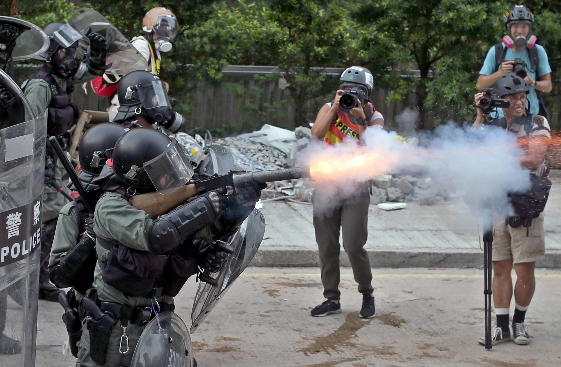 Hong Kong police fire tear gas as protests take violent turn