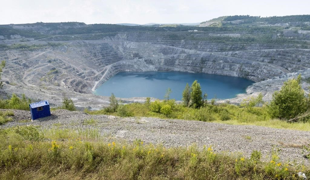 The open pit of the now closed Jeffrey mine is seen in Asbestos Que. Wednesday Aug. 10 2016. THE CANADIAN PRESS  Paul Chiasson