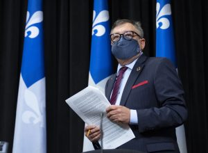 Quebec's public health director says he has a driver and bodyguard because of threats