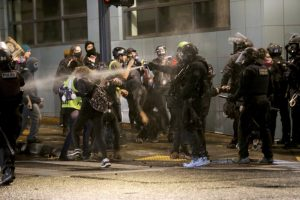 Portland protesters set fire at police building, 14 arrested