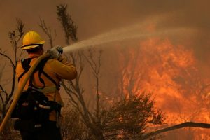 Desert communities told to evacuate as winds stoke flames