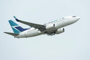 WestJet warns furloughed workers of pay cut as CERB ends